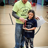 From left, Keith Rudy takes a picture with Alexia Comtois, 8, of Lowell who won first place for the girls in her age division. SUN/Caley McGuane