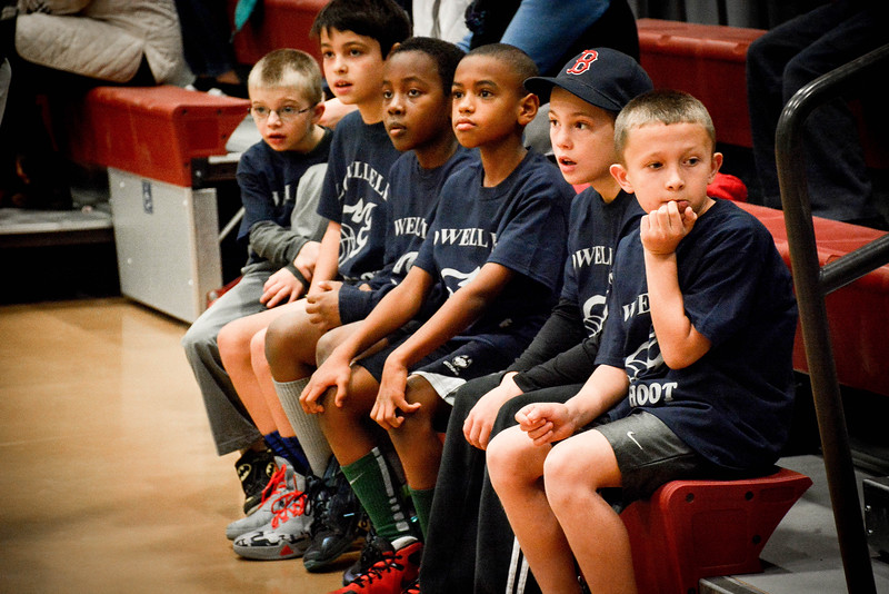 Kids anxtiously wait to compete in the free-throw shooting contest at the Butler Middle School in Lowell on Saturday. SUN/Caley McGuane