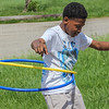 Kevin works multiple hula hoops.