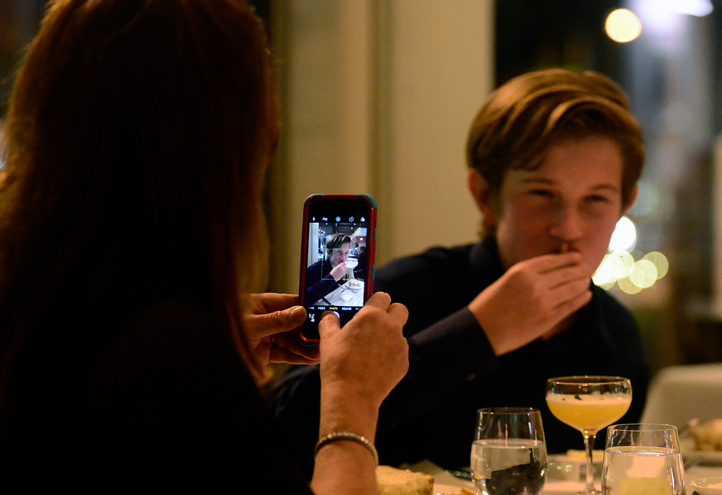 . Linda Schwartz takes a photo of Colter Heap as he enjoys one course of his meal at  Frasca Food & Wine in Boulder on Tuesday night. Colter along with his sister Maryn run a restaurant review website called Kids\' Kritics. Schwartz is the siblings homeschool teacher. For more photos go to dailycamera.com Paul Aiken Staff Photographer Nov 14, 2017