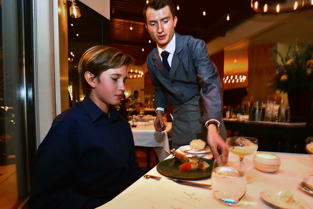 . Waiter Paul Toner delivers a course to Colter Heap at Frasca Food & Wine in Boulder on Tuesday night. Colter along with his sister Maryn run a restaurant review website called Kids\' Kritics. For more photos go to dailycamera.com Paul Aiken Staff Photographer Nov 14, 2017