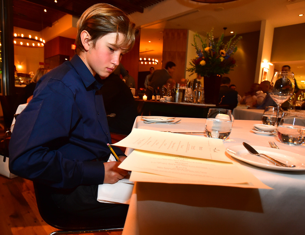 . Colter Heap takes notes off the menu at  Frasca Food & Wine in Boulder on Tuesday night. Colter along with his sister Maryn run a restaurant review website called Kids\' Kritics. For more photos go to dailycamera.com Paul Aiken Staff Photographer Nov 14, 2017