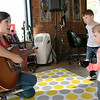 Alissa Coates Children's Music was the entertainment for the kids at Strong Style Coffee in Fitchburg on Saturday morning, Nov. 2, 2019. Coates, with a Wonder Woman shirt on, sings to the kids. SENTINEL & ENTERPRISE/JOHN LOVE