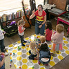 Alissa Coates Children's Music was the entertainment for the kids at Strong Style Coffee in Fitchburg on Saturday morning, Nov. 2, 2019. Coates,with a Wonder Woman shirt on, sings to the kids. SENTINEL & ENTERPRISE/JOHN LOVE