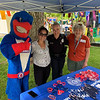 UMass Lowell mascot Rowdy the Riverhawk, aka Bryan Costa of Lowell, with Molyla Tieng, Officer Mindy Dower and Phyllis Harris-Swenson, all of Lowell