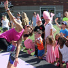 Lynnfield, Ma. 9-24-17. Sharon Marrana leads children and adults in dynamic activities at the third annual Kid's Karma at MarketStreet on Sunday.