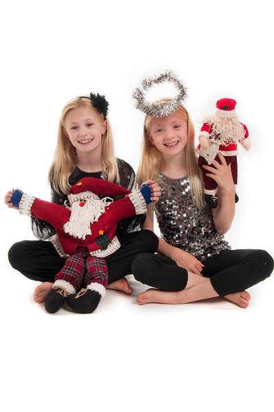 pretty blonde girls, holding Christmas santas and wearing a tinsel halo, isolated on white,