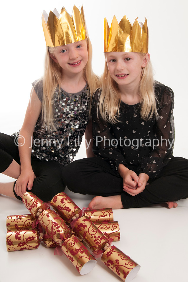 pretty blonde girls with Christmas hats an Christmas crackers, isolated on white background