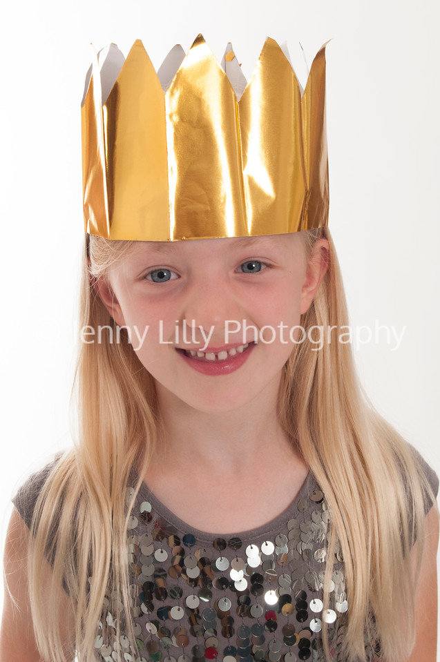 pretty blonde girl with gold Christmas crown isolated on white background