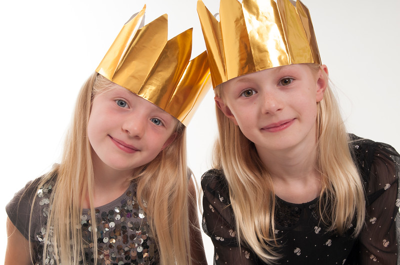 pretty blonde girls with Chrismas Crowns, isolated on white background