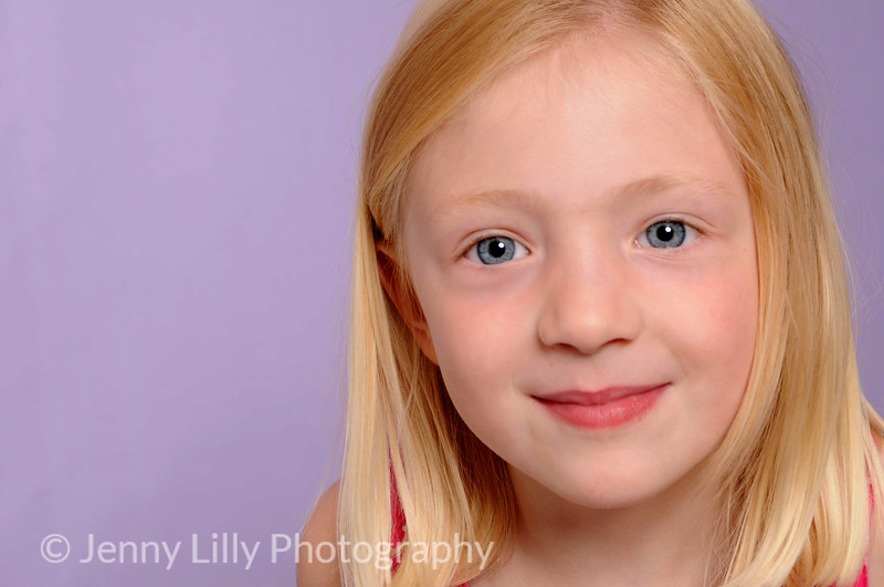 pretty blonde girl isolated on lilac background