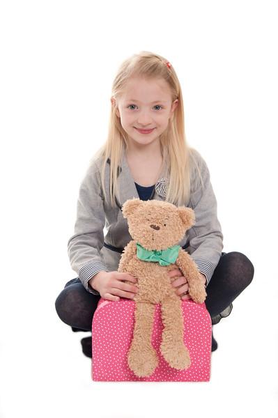 pretty blonde girl cuddling her teddy bear
