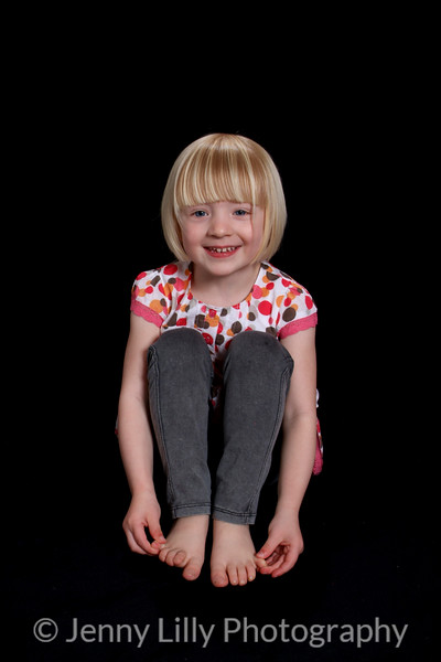 pretty blonde girl isolated on black background