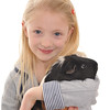 pretty blonde girl holding her pet guinea pig, isolated on white background