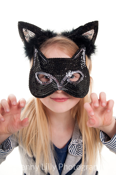pretty blonde girl pretending to be a cat, isolated on white background