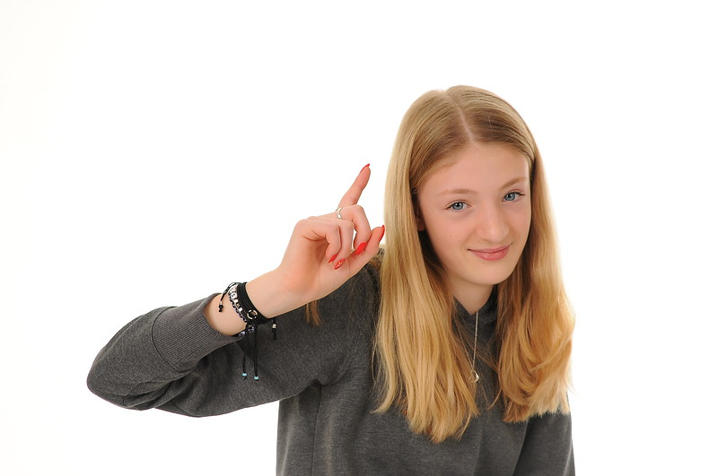 pretty blonde teenage girl with attitude, isolated on white background
