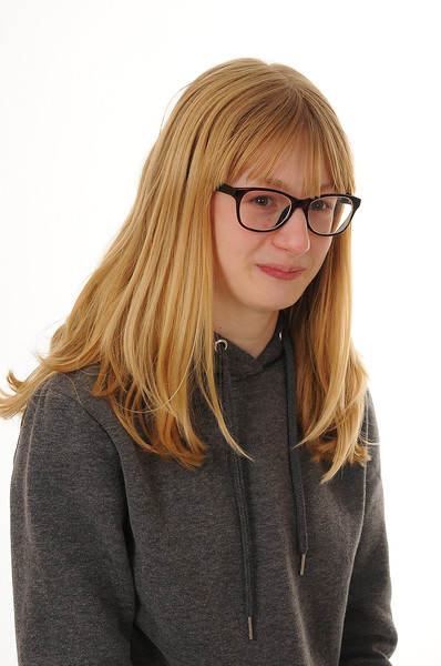 pretty blonde girl wearing glasses, isolated on white background