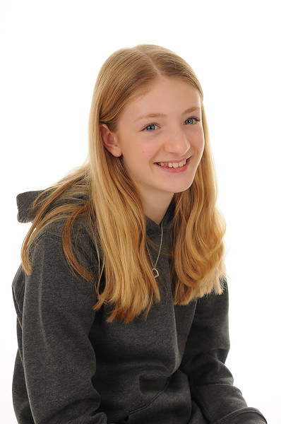 pretty blonde teenage girl smiling, isolated on white background