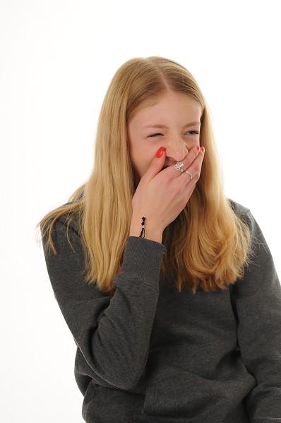 pretty blonde teenage girl yawning isolated on white background