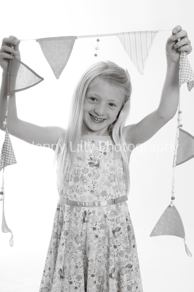 pretty blonde girl holding bunting isolated on white