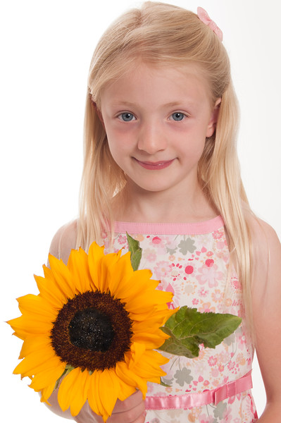 pretty blonde girl with sunflower isolated on white background