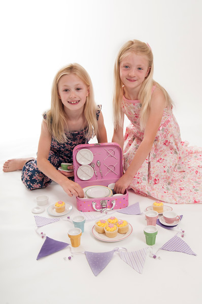 pretty blonde girls having a tea party, isolated on white background
