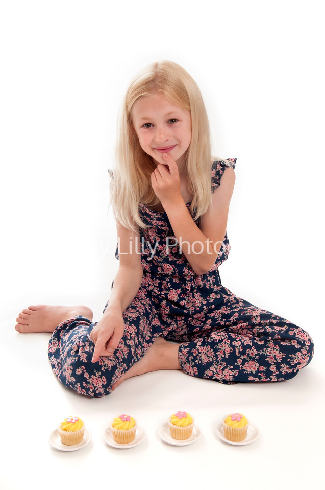 pretty blonde child having a tea party, isolated on white background