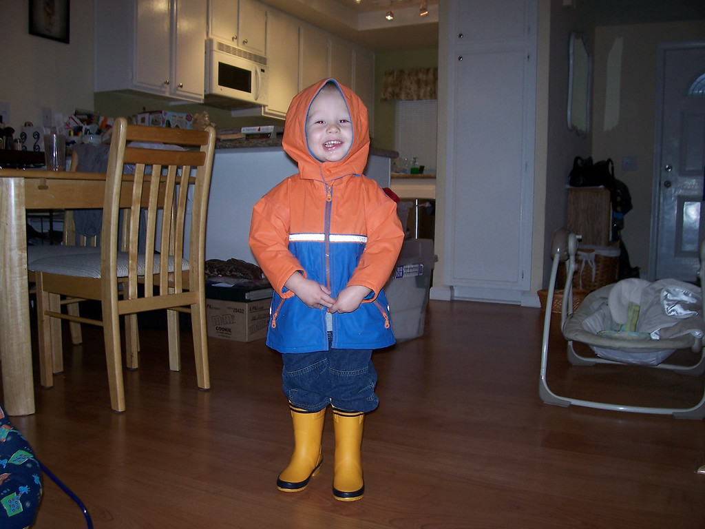 Sam is ready to go out in the rain and splash in the puddles!
