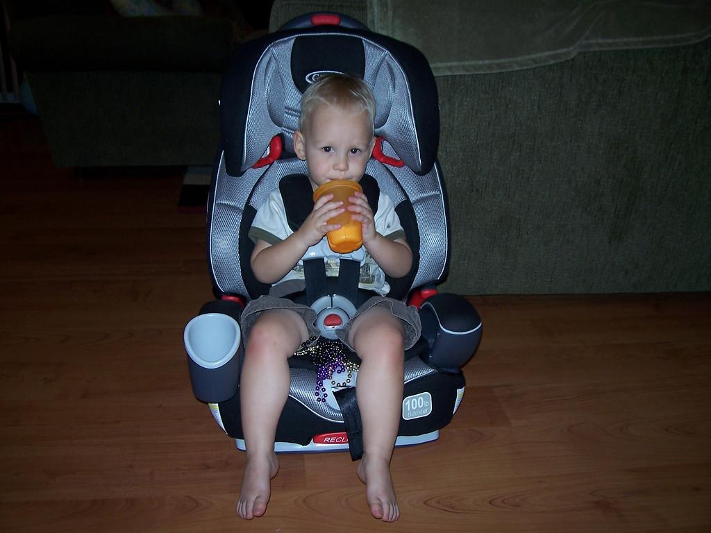 Sam loves his new car seat!