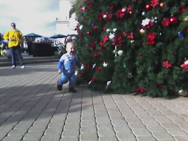 Chasing Ian around the Christmas tree!