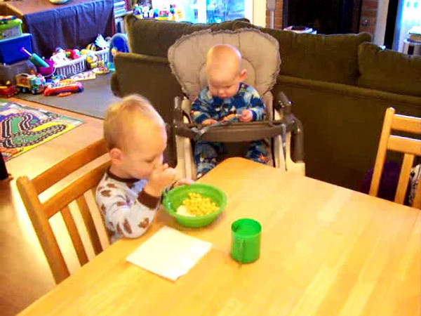 Sam must be very focused on his breakfast to be able to put up with such a noisy little brother.