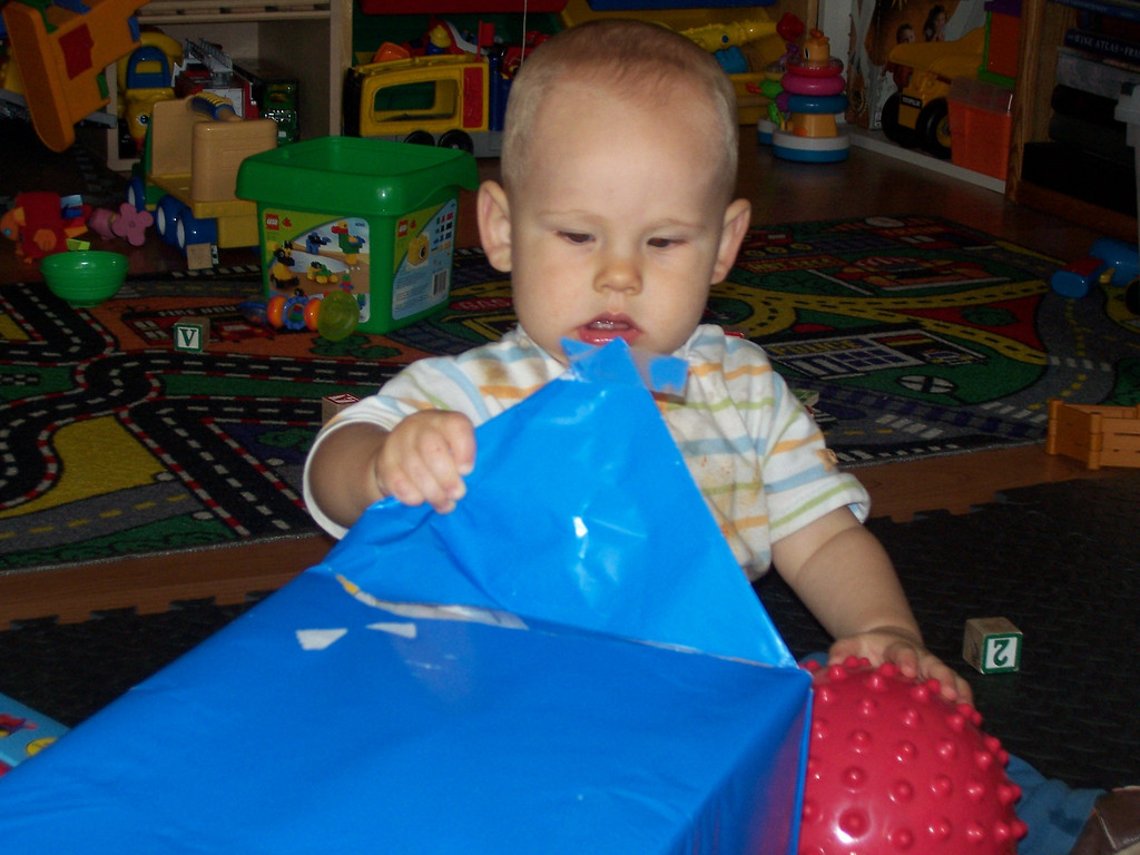 Cameron opening his first birthday present. Thank you Grandpa Carl and Grandma Linda!