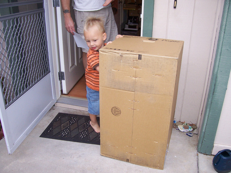 Sam is going to carry the new Microwave in for us... he is pretty strong, not to mention the box is almost as big as he is!