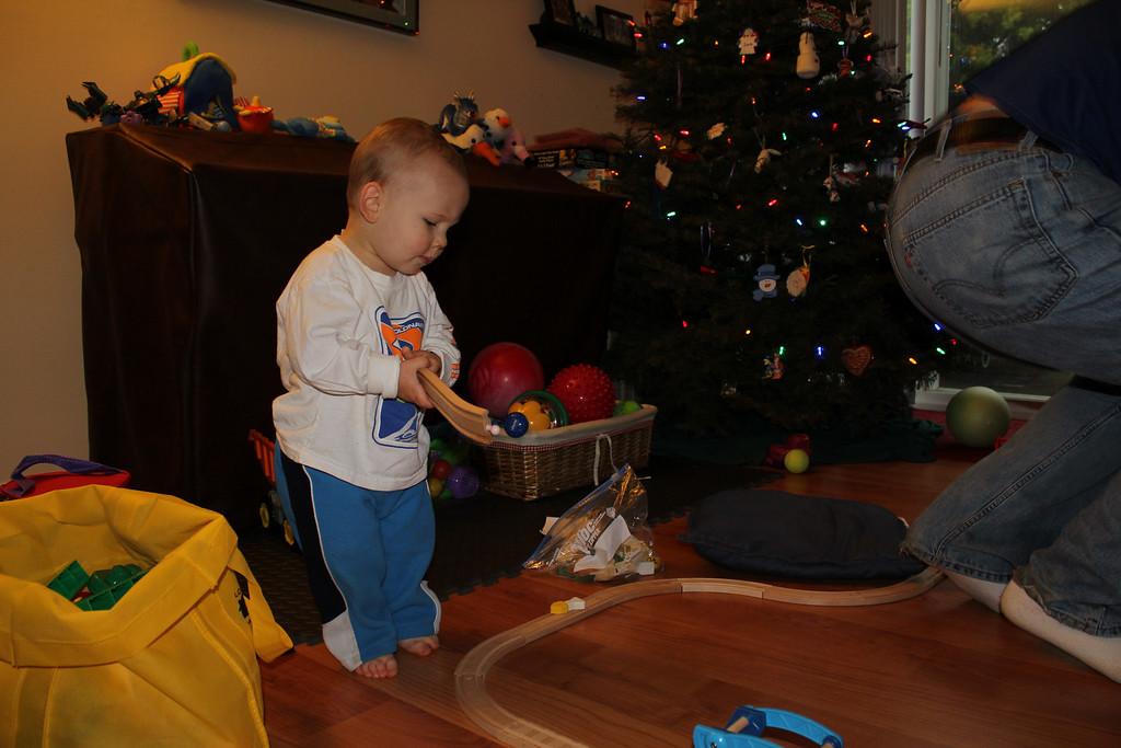 Helping Daddy build a train track