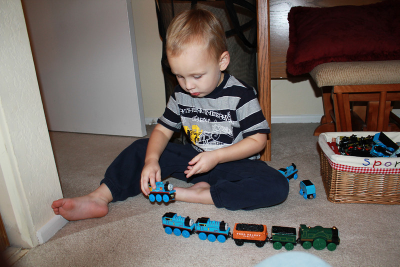 Sam is putting a long train together