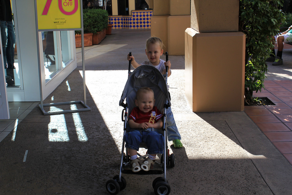 Christmas Eve Sam had a great time pushing Cameron in the stroller at the mall.