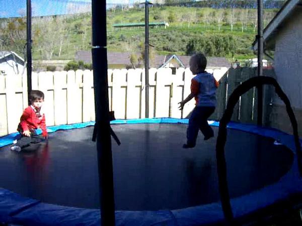 Sam & Kaden jumping.