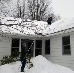 Mike stopping by for the weekend, helping out the clean out the roof in preparation for the next snowstorm.