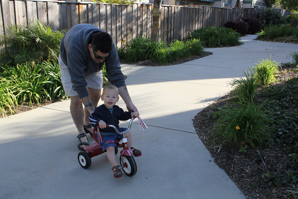 Cameron riding the trike