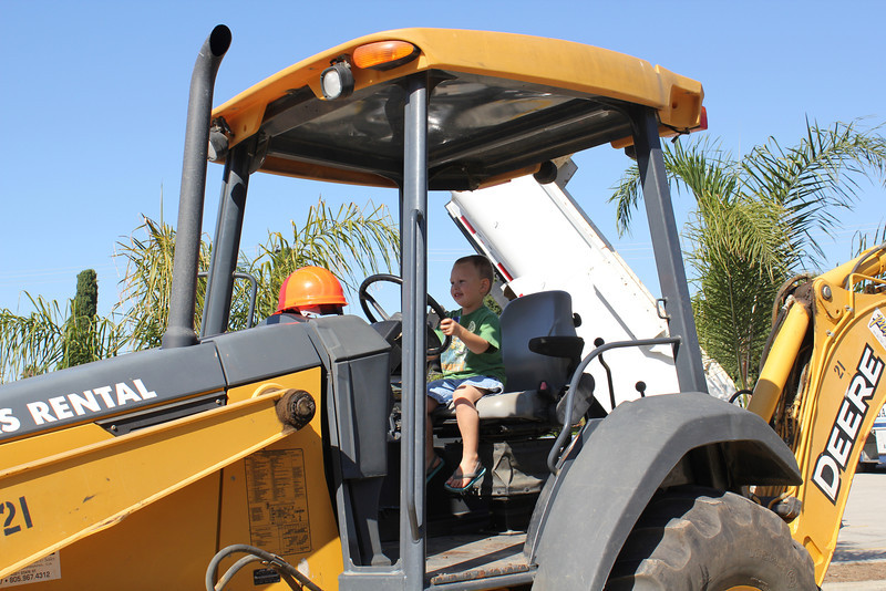 "Sam and Mom went to a ""Touch a Truck"" event. Sam got to sit a a lot of different tractors, trucks and emergency vehicles"