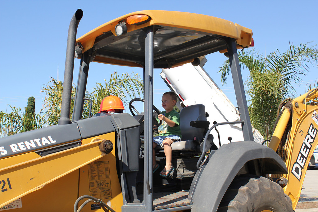 """Sam and Mom went to a """"Touch a Truck"""" event. Sam got to sit a a lot of different tractors, trucks and emergency vehicles"""