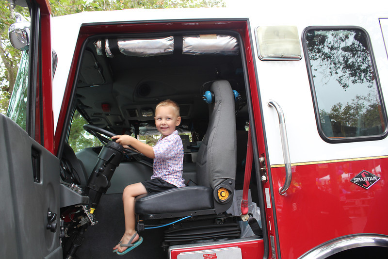 Sam got to sit in a fire engine at the Baby Fair