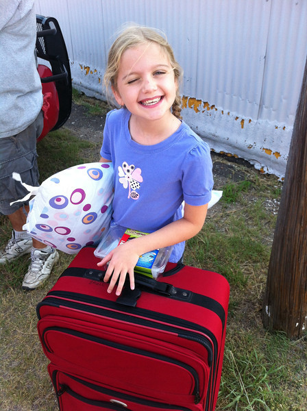 Maggie ready to board the bus to camp