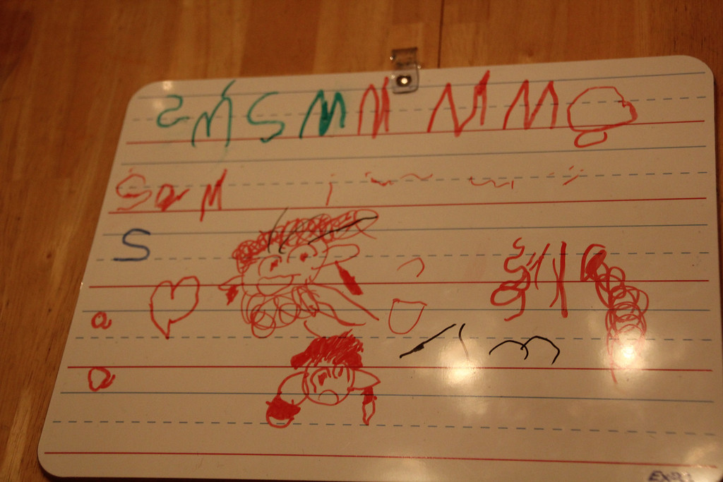 Sam wrote the letters as well as drew the faces
