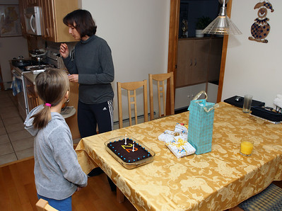 Mike's 22nd birthday's home cake bash. Candles lit up!