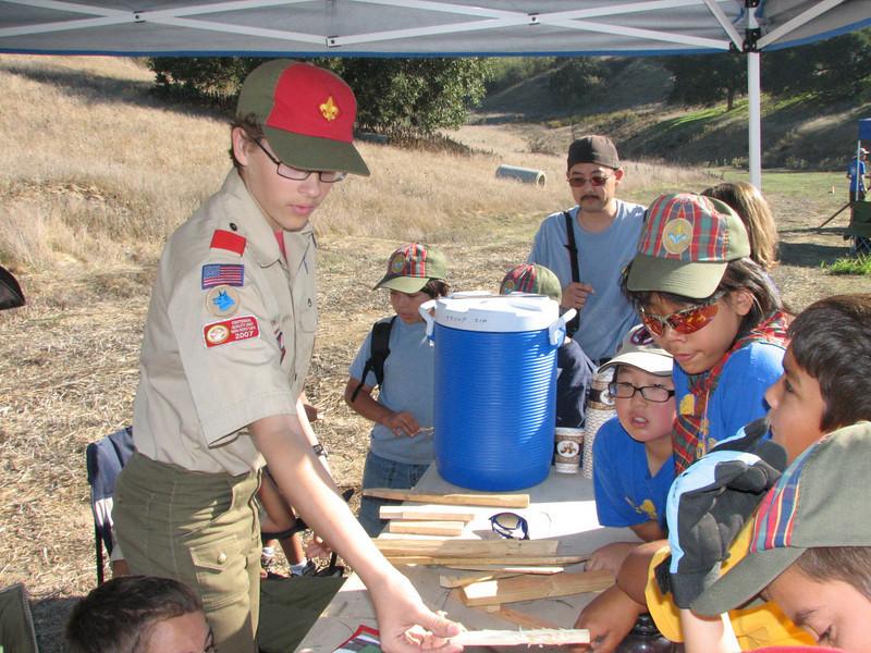Kenton teaching Webelos about firestarting techniques.