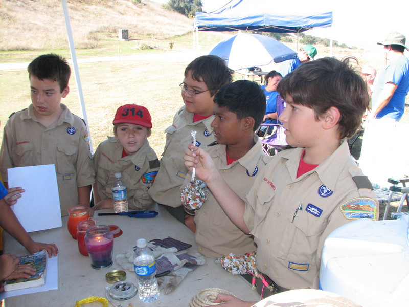 Dylan, Andrew, Robert, Noel, and Danny teach the Webelos about whipping and fusing rope.