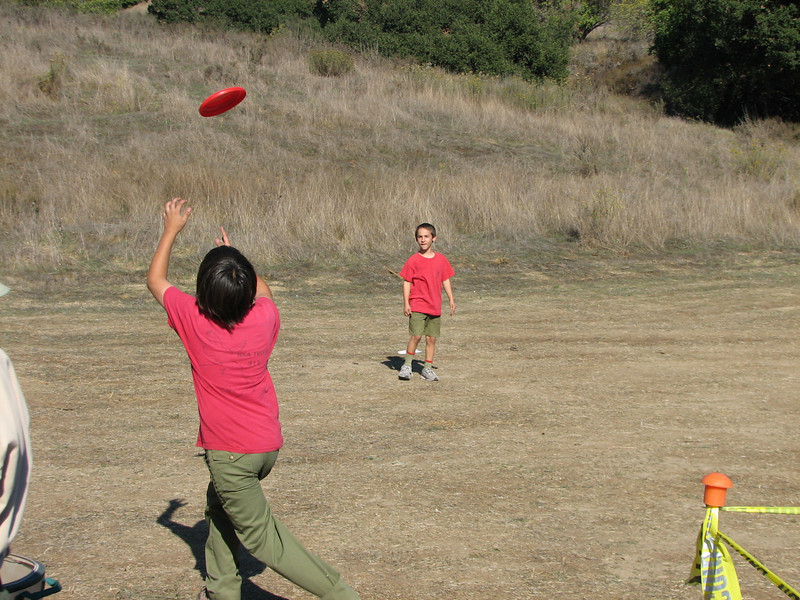 Justin and Ian play a lively game of Frisbee. Troop 657 was giving out free discs.
