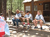 Sunday - Getting the camp briefing at the Health Lodge. Camp nurse is on far right.