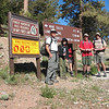Just before starting the hike. I don't know why John stood behind the sign.<br /> L-R: Me, Joseph, John, Alec, Simon.
